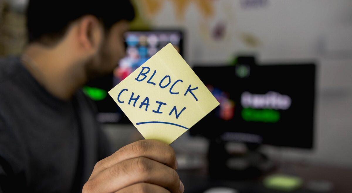 Man with Blockchain postit